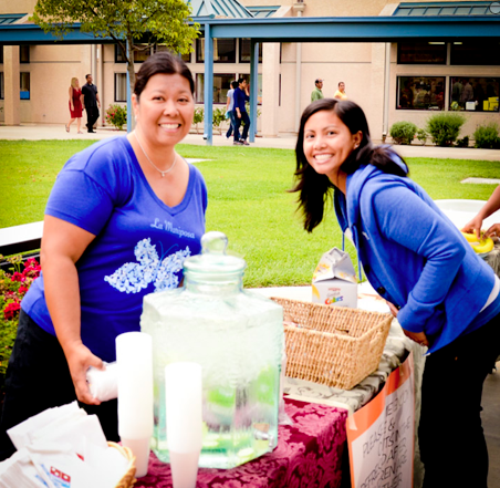 PTA President, Cindy Laudato-Wong, and volunteer Cheryl Arenzana welcome back LM Families with a reception in the quad.