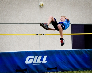 "5th Grade Boy, Brady B. clears the highest jump of the day, 3'9""."