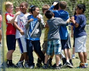 Make sure you can handle the congratulations!  A 5th grade student receives enthusiastic congrats from his buddies.