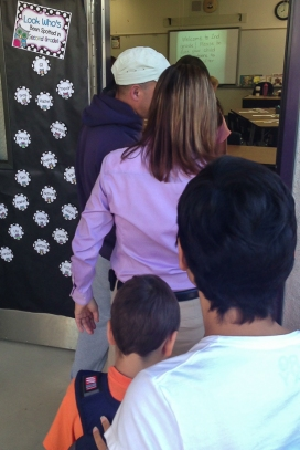 2nd graders line up to see their classroom.