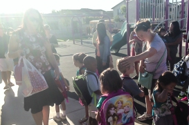 Brand new kindergarteners line up to meet their teacher.