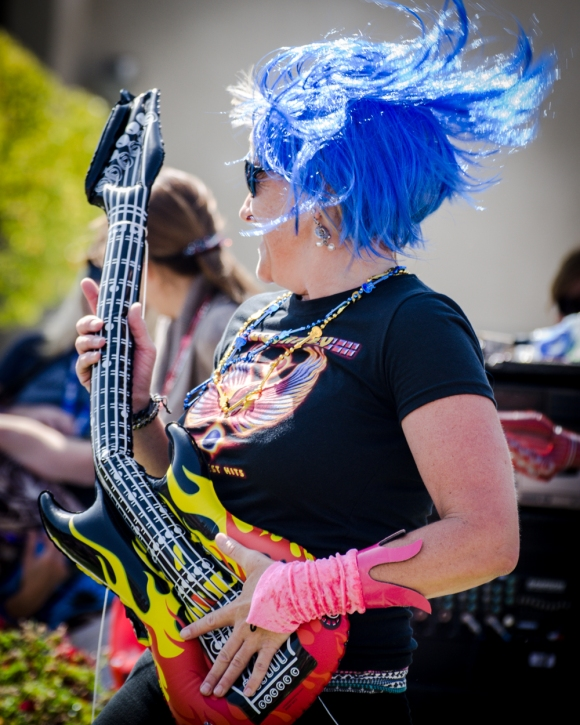 Mrs. Scrivener on fire with her guitar.
