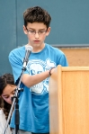 """Landon """"writes"""" his word on the podium with his finger before spelling it out loud."""