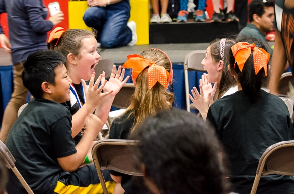 Superquiz team member Jenna C. reacts with LM CAO Champ Hailey J. when they find out they've won the event.