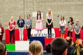 Hailey receiving her gold medal in English Grammar.